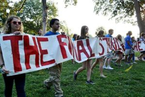 University of Alabama students, faculty and others march from the steps Amelia Gayle Gorgas Library to Rose Administration Building on campus to protest racial segregation in the school's greek system in the early morning on Wednesday, Sept. 18, 2013. (Ben Flanagan/al.com)